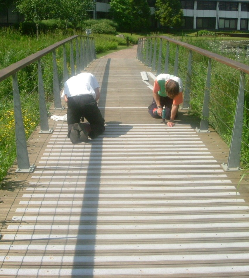 GRP sheets being installed on wooden walkway