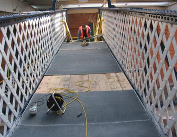 GRP panels being installed on railway bridge